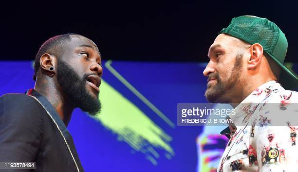 Boxers Deontay Wilder and Tyson Fury faceoff during a press conference in Los Angeles California on January 13 2020 ahead of their rematch fight in...