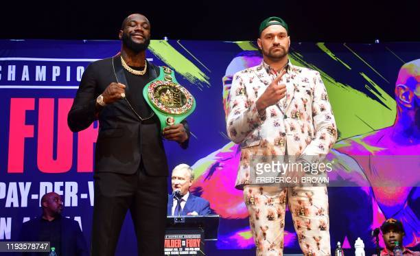 Boxers Deontay Wilder and Tyson Fury gesture on arrival for a press conference in Los Angeles California on January 13 2020 ahead of their rematch...