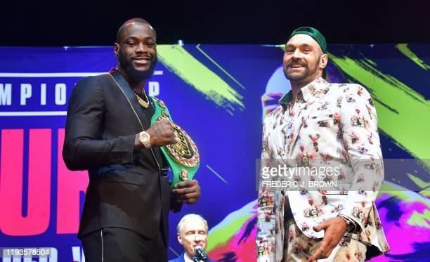 Boxers Deontay Wilder and Tyson Fury meet on stage during a press conference in Los Angeles California on January 13 2020 ahead of their rematch...
