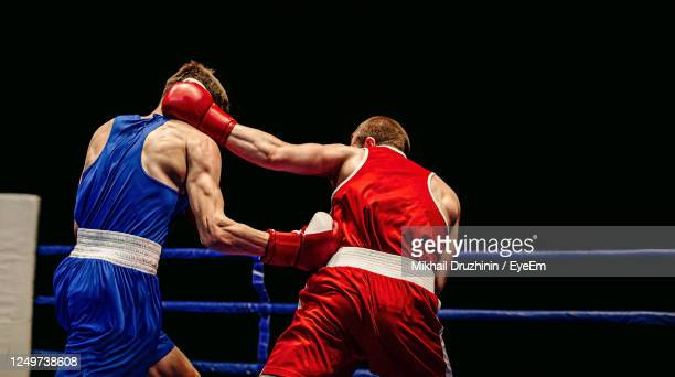 boxers fighting in ring - boxing stock pictures, royalty-free photos & images