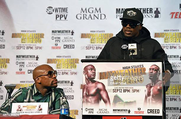 Boxers Floyd Mayweather Jr and Andre Berto attend a news conference at MGM Grand Hotel Casino on September 9 2015 in Las Vegas Nevada Mayweather will...