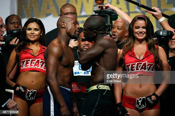 Boxers Floyd Mayweather Jr and Andre Berto face off during their official weighin at MGM Grand Garden Arena on September 11 2015 in Las Vegas Nevada...