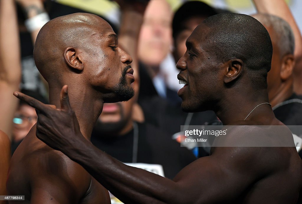 Boxers Floyd Mayweather Jr. (L) and Andre Berto face off during their official weigh-in at MGM Grand Garden Arena on September 11, 2015 in Las Vegas, Nevada. Mayweather will defend his WBC/WBA welterweight titles against Berto on September 12 at MGM Grand in Las Vegas.