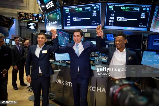 Boxers Gennady 'GGG' Golovkin left and Daniel 'The Miracle Man' Jacobs right stands for photographs with Tom Farley president of the NYSE Group Inc...