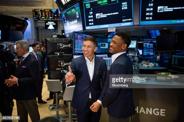 Boxers Gennady 'GGG' Golovkin left and Daniel 'The Miracle Man' Jacobs stand for photographs on the floor of the New York Stock Exchange in New York...