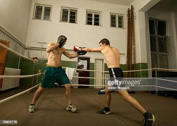 Boxers in a boxing ring fighting
