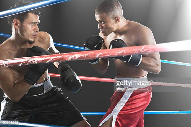 boxers in action - boxing stock pictures, royalty-free photos & images