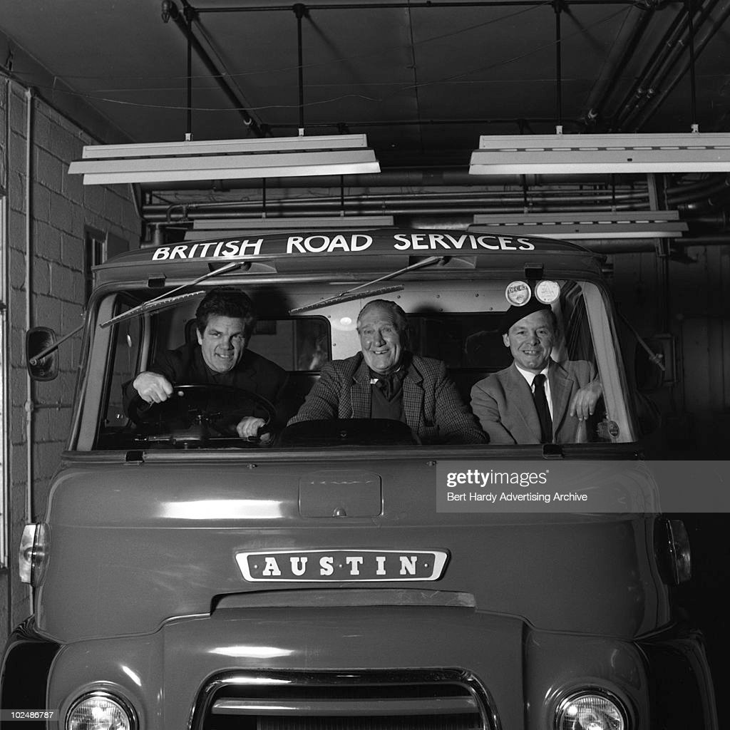 Boxers in the cab of an Austin lorry at the BMC (British Motor Corporation) in Holland Park, London, 12th February 1963. They are Bombardier Billy Wells (1889 - 1967), Harry 'Kid' Berry and Freddie Mills (1919 - 1965).