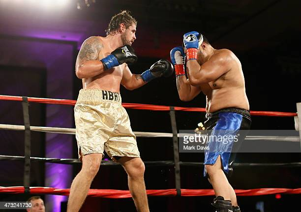 Boxers Joshua Clark and Natu Visinia fight during the B Riley Co And Sugar Ray Leonard Foundation's 6th Annual Big Fighters Big Cause Charity Boxing...