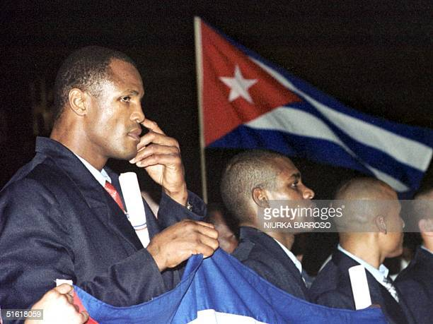 Boxers Juan Hernandez Sierra Felix Savon and Rubalcaba listien to Cuban president Fidel Castro's speech welcoming the boxers back to Havana from the...