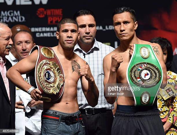 Boxers Juan Manuel Lopez and Francisco Vargas pose during their official weighin at the MGM Grand Garden Arena on July 11 2014 in Las Vegas Nevada...