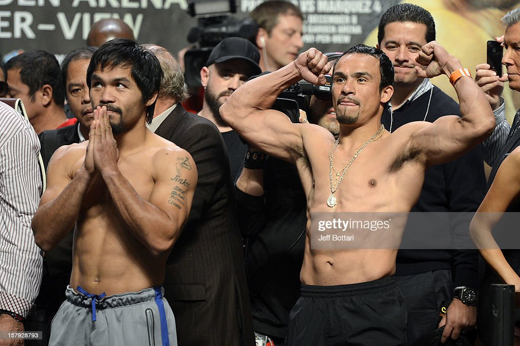 Boxers Manny Pacquiao (L) and Juan Manuel Marquez pose during the official weigh-in for their welterweight bout at the MGM Grand Garden Arena on December 7, 2012 in Las Vegas, Nevada. Pacquiao and Marquez will fight each other for the fourth time on December 8 in Las Vegas.