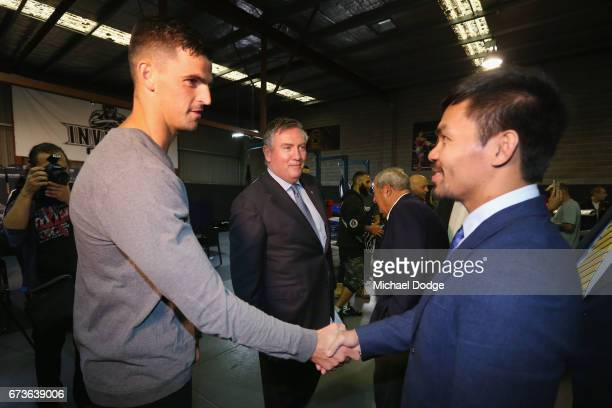 Boxers Manny Pacquiao of the Philippines meets AFL Player Scott Pendlebury of the Collingwood Magpies and Magpies President and host for today Eddie...
