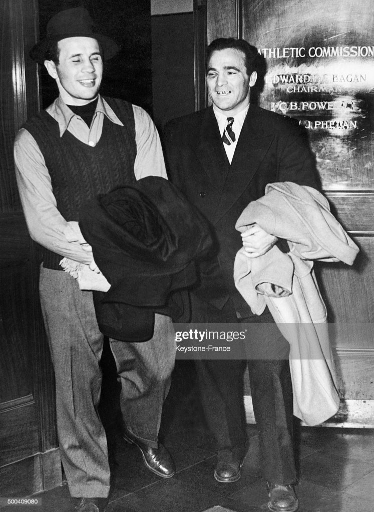 Boxers Marcel Cerdan and Georgie Abrams after being examined before fighting on December 5, 1946 in New York, United States.