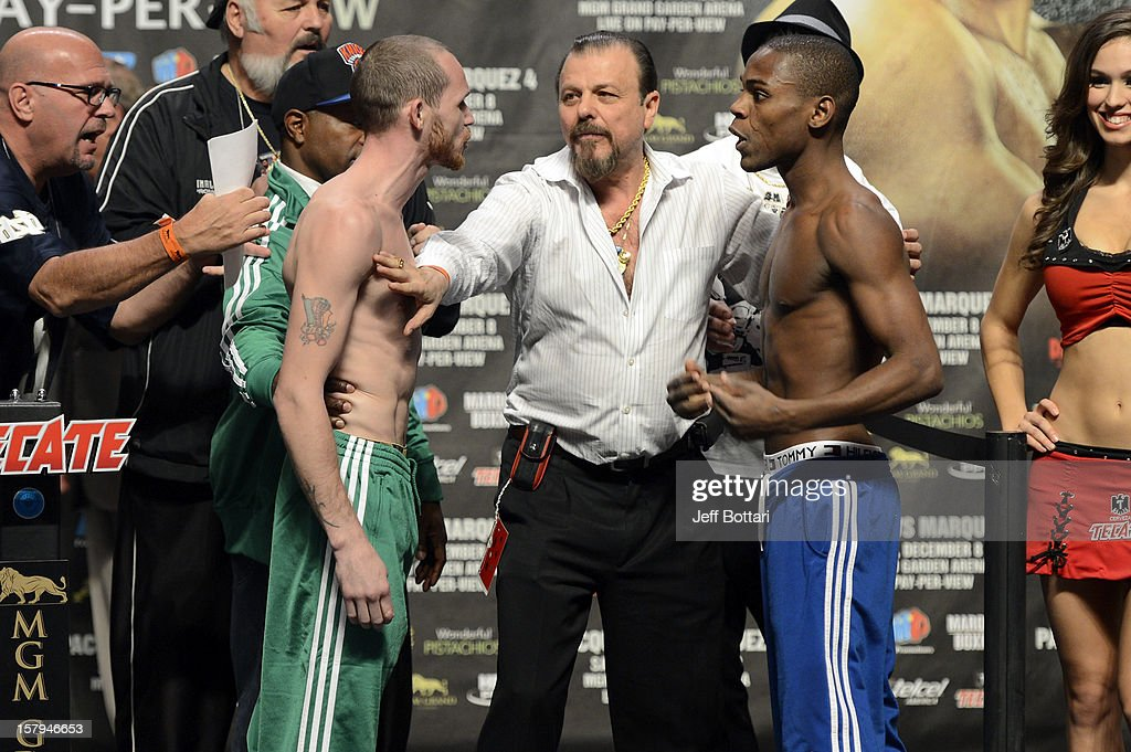 Boxers Patrick Hyland (L) and Javier Fortuna get into a scuffle during the official weigh-in for their WBA interim featherweight title bout at the MGM Grand Garden Arena on December 7, 2012 in Las Vegas, Nevada.