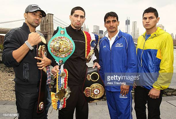 Boxers Paul Malignaggi Danny Garcia Erik Morales and Pablo Cesar Cano pose during a photo call in front of the Brooklyn Bridge on October 15 2012 in...