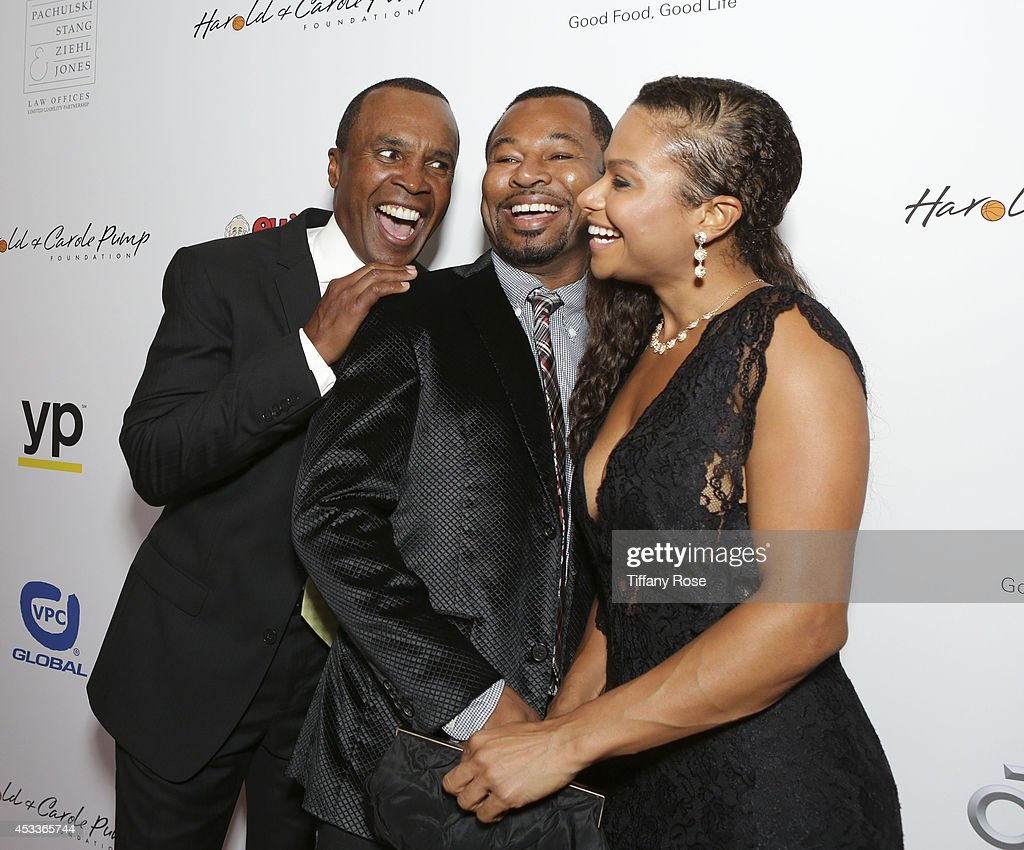 Boxers Sugar Ray Leonard and Sugar Shane Mosley and Bella Gonzalez attend the 14th Annual Harold & Carole Pump Foundation Event on August 8, 2014 in Los Angeles, California.