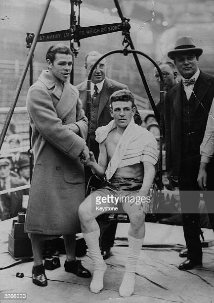 Boxers Tommy Milligan and Mickey Walker at a public weighin at Olympia London before their middleweight world title fight Walker won and retained his...