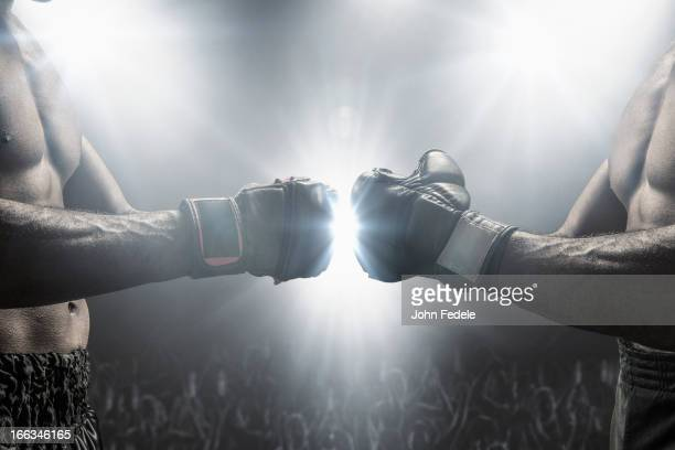 boxers touching gloves before fight - mixed martial arts stockfoto's en -beelden