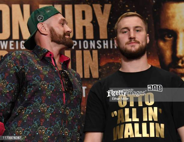 Boxers Tyson Fury and Otto Wallin joke around as they pose during a news conference at MGM Grand Hotel Casino on September 11 2019 in Las Vegas...