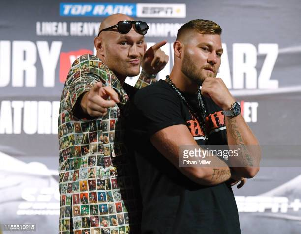 Boxers Tyson Fury and Tom Schwarz pose during a news conference at MGM Grand Hotel Casino on June 12 2019 in Las Vegas Nevada The two will meet in a...