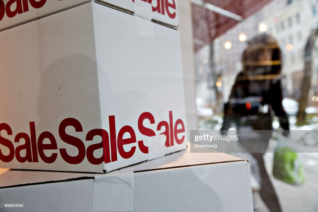 Boxes advertising a sale sit in a window display of a Crate & Barrel Canada Inc. store at the Magnificent Mile commercial district in Chicago, Illinois, U.S., on Friday, Dec. 29, 2017. Bloomberg is scheduled to release consumer comfort figures on January 4. Photographer: Daniel Acker/Bloomberg via Getty Images