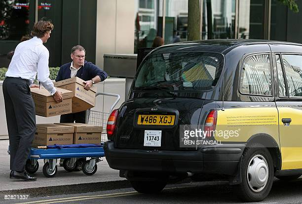 Boxes are loaded into a waiting taxi outside the Lehman Brothers European Headquarters building in Canary Wharf, east London, on September 15, 2008....