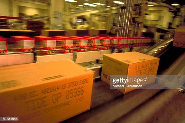 Boxes cases of Tide detergent moving on conveyers at Procter Gamble's factory re co's continuous product replenishment factory to store restocking...