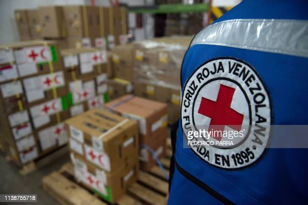 Boxes containing humanitarian aid are storaged at the Venezuelan Red Cross headquarters in Caracas on April 22 2019 The issue of humanitarian aid has...
