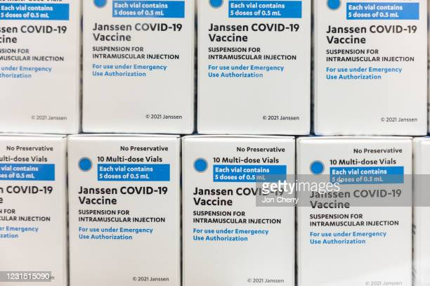 Boxes containing Janssen COVID-19 vials are stacked upon each other shortly after their delivery to Louisville Metro Health and Wellness headquarters...