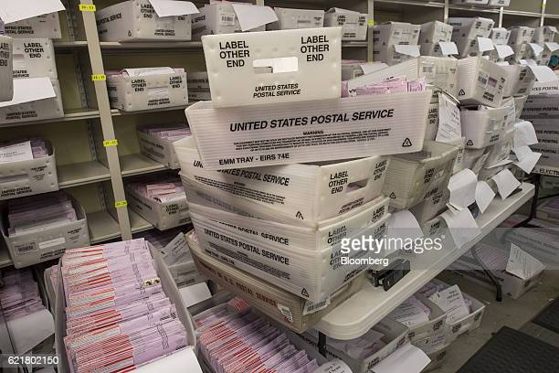 Boxes containing mailinballots sit waiting to be sorted at the San Francisco City Hall polling location in San Francisco California US on Tuesday Nov...