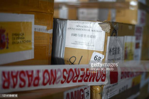 Boxes containing sanitary material donated by the city of Beijing to the City of Madrid, are stacked at the Casa de Campo's Glass pavilion in Madrid...