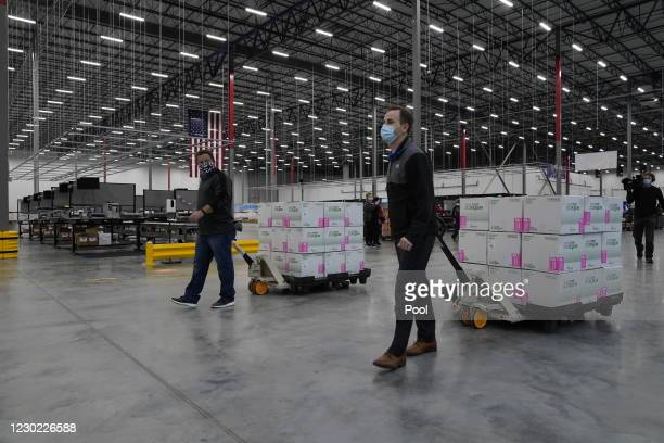 Boxes containing the Moderna COVID-19 vaccine are prepared to be shipped at the McKesson distribution center in Olive Branch, Mississippi. The...