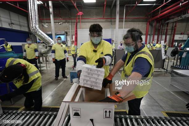 Boxes containing the Pfizer-BioNTech COVID-19 vaccine are prepared to be shipped at the Pfizer Global Supply Kalamazoo manufacturing plant on...