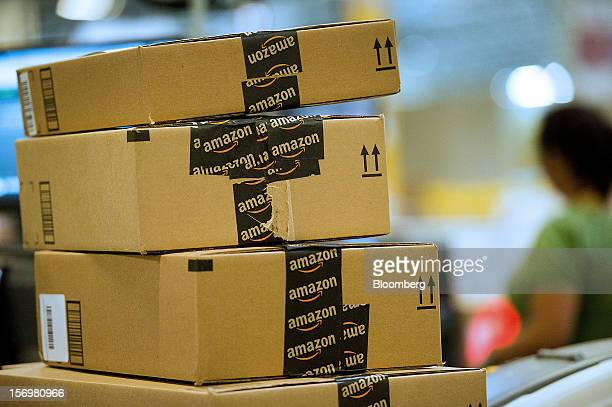 Boxes filled with merchandise sit stacked before shipment at the Amazoncom Inc distribution center in Phoenix Arizona US on Monday Nov 26 2012 US...