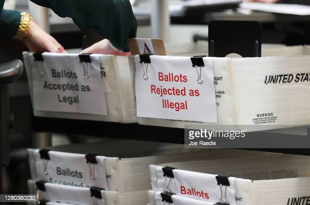 Boxes for Vote-by-Mail ballots that have been rejected or accepted due to signature discrepancies are seen as the Miami-Dade County Canvassing Board...