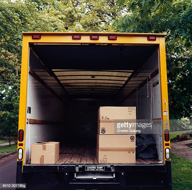 boxes in back of moving van - removal stock pictures, royalty-free photos & images