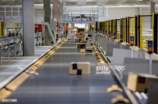 Boxes move along a conveyor belt at an Amazoncom Inc fulfillment center in Koblenz Germany on Tuesday Nov 29 2016 Ecommerce sales in November and...