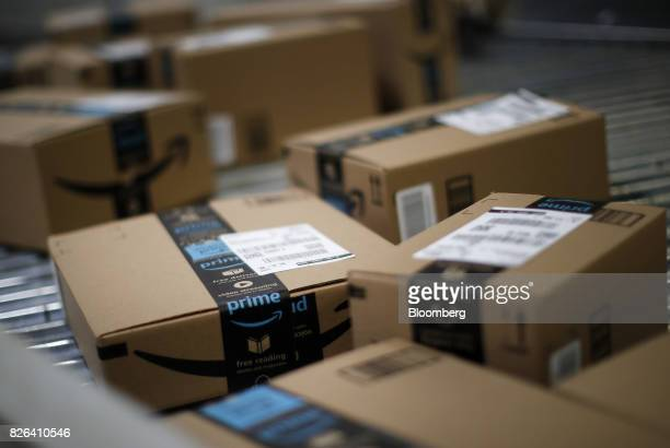 Boxes move along a conveyor belt at the Amazoncom fulfillment center in Kenosha Wisconsin US on Tuesday Aug 1 2017 Amazoncom Inc held a giant job...