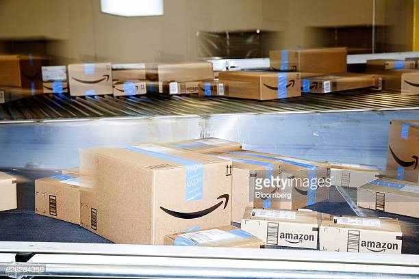 Boxes move along a conveyor belt inside an Amazoncom Inc fulfillment center in Robbinsville New Jersey US on Monday Nov 28 2016 In 2005 retailers...