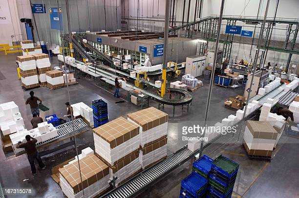 Boxes move along conveyor belts inside a warehouse at a United Parcel Service Inc Healthcare Supply Chain and Distribution Center in Atlanta Georgia...