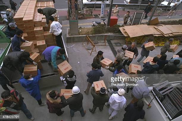 Boxes of aid supply are unloaded on January 18 1995 in Kobe Hyogo Japan Magnitude 73 strong earthquake jolted in the morning of January 17 1995 in...