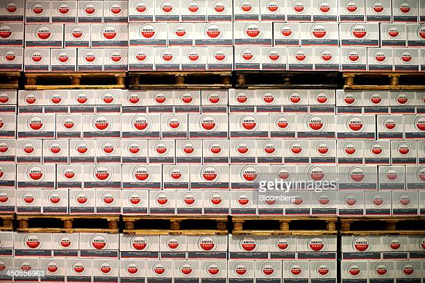 Boxes of Amstel Pulse lager sit stacked on pallets before distribution at the Heineken NV brewery in Den Bosch Netherlands on Tuesday Nov 19 2013...