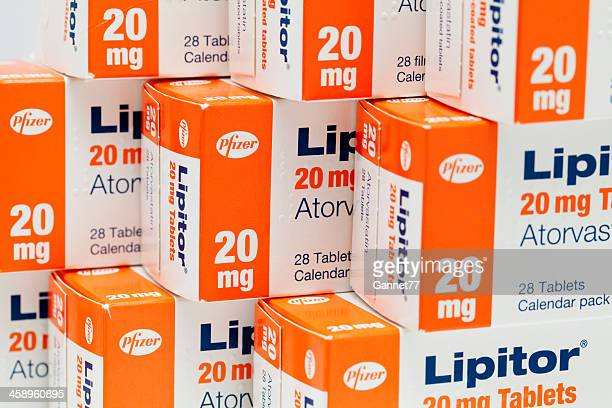 boxes of atorvastatin (lipitor) tablets - pfizer stock pictures, royalty-free photos & images