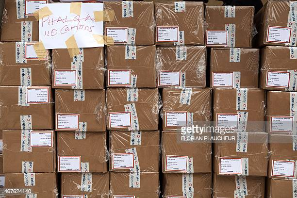 Boxes of ballot papers are seen at the Independent National Electoral Commission offices in the oil hub of Port Harcourt on March 26 ahead of March...
