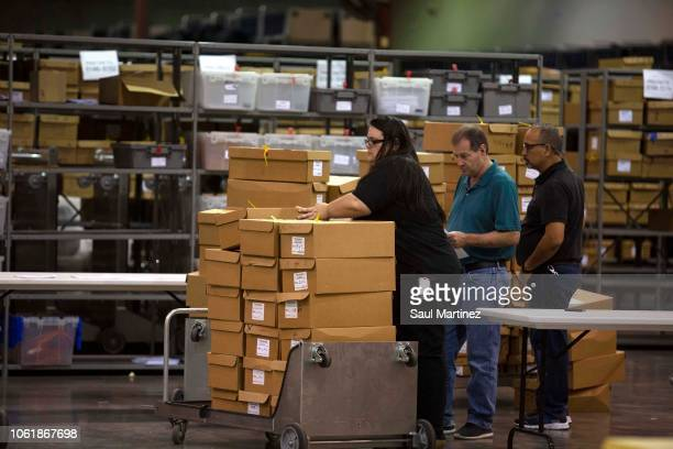 Boxes of ballots are moved by workers at the Supervisor of Elections Service Center on November 15 2018 in Palm Beach Florida Three close midterm...