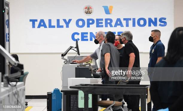 Boxes of ballots arrive to be counted at the tallying center in Downey, California, on September 14 after the close of voting in California's...