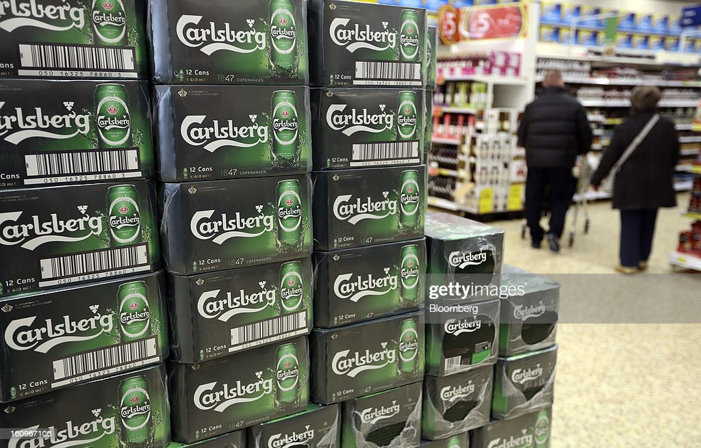 Boxes of Carlsberg lager beer, produced by Carlsberg A/S, sit on display inside a supermarket in London, U.K., on Friday, Feb. 8, 2013. Britain's economy will grow more slowly this year than previously forecast and stagnation may persist, according to the National Institute of Economic and Social Research. Photographer: Chris Ratcliffe/Bloomberg via Getty Images