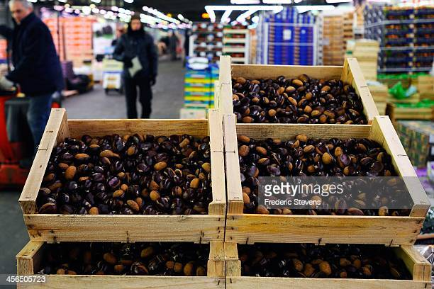 Boxes of chestnuts are displayed in the fruits and vegetables department of the Rungis Market on December 13 2013 in Rungis France Rungis is the...