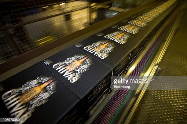 Boxes of Chivas Regal whisky travel along a conveyor belt at the Pernod Ricard SA bottling plant in Paisley UK on Thursday Nov 18 2010 Pernod Ricard...
